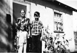 Ivars Graudins with his brother and grandmother at the front door of their house in Yakima,...