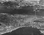 Aerial view of downtown Seattle including  the Jackson Street Community Area, ca. 1950's