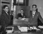 Artist J.A. Arzadon presenting a painting to the Phillipine Consul, November 20, 1952