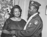 Johnnie Jenkins dressed in an American Legion uniform, accompanied by his wife, July 5, 1958