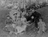 Group portrait of Semple and Mizner famly members in grass, ca. 1890s