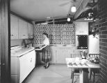 1956 Homes for Better Living Award contest for house at 258 N 171st St showing kitchen interior,...