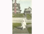 Little girl in white coat, hat, and gaiters, probably Seattle, ca. 1905