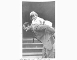 Child riding on man's back, probably Seattle, ca. 1907