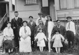 Tatsuya, Kan, Clarence, Tom, Catherine, Lillian Arai with five others standing outdoors, ca. 1912...