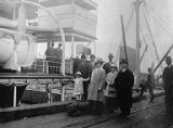 Tatsuya Arai and others near a steamship, ca. 1894-1922