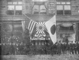 Japanese men in front of Lung Kee & Co. Garments, ca. 1910s