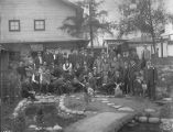 Group of Japanese men, women, and children outdoors at the Alaska Yukon Pacific Exposition...