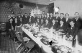 Tatsuya Arai and other men gathered for a meal, Seattle, 1911