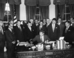 Senator Warren G. Magnuson at Federal Airport Act signing with President John F. Kennedy, Lyndon...