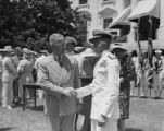 President Harry S. Truman shaking hands with man in uniform at Presidential Unit Citation,...