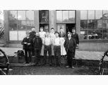 Group of men and women in front of 203 Western Ave., Seattle, 1895