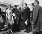 Jermaine Magnuson and Senator Warren G. Magnuson standing near Scandinavian Airlines plane at...