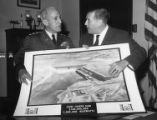 Lieutenant General E.C. Itschner presenting Senator Warren G. Magnuson with picture of Chief...