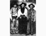 Studio portrait of three men dressed as cowboys, ca. 1919