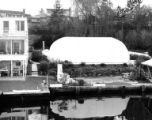 Air: Seal Airhouse at a private residence next to a body of water, possibly Seattle, ca. 1950s