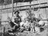 Herb Crisler sitting with a pile of vegetables at the Humes Ranch, Olympic Peninsula, 1945