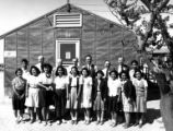 Budget and Accounting Unit workers outside the office, Minidoka Relocation Center, ca. 1943-1945