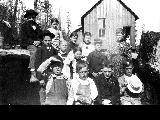 Home Colony,  children in front of original schoolhouse, ca. 1900
