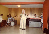 Hotcha Hinton performing with a band, location unknown, 1980