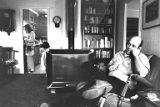 Kent Martin sitting in chair at home with family, 1979-1980