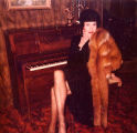 Jackie Starr at 74 years old sitting by piano, probably Seattle, 1985