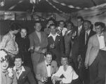 A large group of people drinking-likely following the wedding of Jackie Starr and Bill Scott,...