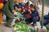 Vegetable vendors and markets,  China, February 1986