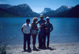 Four people standing in front of lake including Stanford Chen, Box R Ranch, Wyoming, 1985