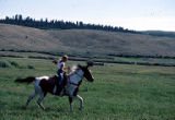 Girl riding horse, Box R Ranch, Wyoming, 1985