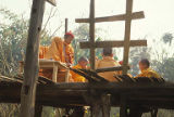 Boys training to be monks in orange robes and hats, Xichuanbana, China, February 1986