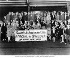 People in front of Pullman car with sign, Swedish American Line Special to Sweden via Great...