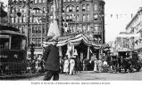 Pioneer Square during Alaska Yukon Pacific Exposition, including horse-drawn carriage, policeman,...