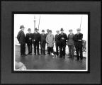 Group of men and a cat on board a ship, ca. 1920