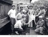 Filipino cannery workers with Giant Pacific Octopus, Alitak, Kodiak Island, ca. 1937