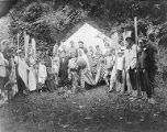 YMCA boy's camp on Orcas island showing large circle of costumed boys and young men standing in...