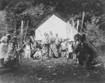 YMCA boy's camp on Orcas island showing group of costumed young men and boys kneeling around two...