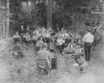 YMCA boy's camp on Orcas island showing Sunday morning service in a forest clearing, 1910