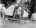 YMCA boy's camp on Orcas island showing two young men doing handstands on parallel bars with...