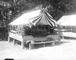 YMCA boy's camp on Orcas island showing platform tent #3 decorated with branches and draped...