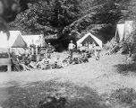 YMCA boy's camp on Orcas island showing young men in front of their tents, 1910
