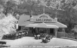 Automobiles parked outside entrance building at Cave of the Winds near Manitou Springs, Colorado,...