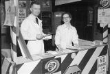 Ad Club members at Traffic Safety Booth, Seattle Auto Show, March, 1953