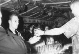 Ken Taylor being served a drink, Joint Meeting with Vancouver, BC Junior Ad Club, November, 1954