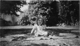 Mary Elizabeth Sanders sitting on blanket on lawn at 5023 15th Ave NE, Seattle, circa 1940-1941