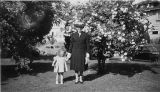 Mary and Mary Elizabeth Sanders in yard near trees at 5023 15th Ave NE, Seattle, circa 1940-1941