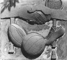 Clay model of sports panel represented by racquet, shoe, basketball, and handshake, Bishop...
