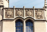 Cast stone parapet ornamentation representing different fields of study, Gerberding Hall,...