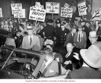 Robert A. Taft in car surrounded by protestors, Seattle, ca. 1946