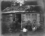 Collier and friends at Barnes' cabin near Marymere Creek, Lake Crescent, Washington, September 1906